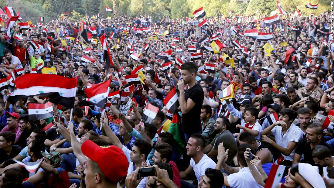 Syrian fans watch their team from Damascus on Tuesday. The nation has been ravaged by civil war.