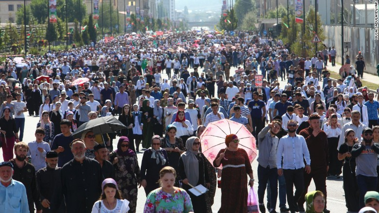 "Local residents walk to attend a mass protest in Chechnya's provincial capital Grozny, Russia, Monday, Sept. 4, 2017. Tens of thousands of people have taken to the streets in Russia's predominantly Muslim Chechnya to protest what the Chechen leader called ""genocide of Muslims"" in Myanmar. (AP Photo/Musa Sadulayev)"