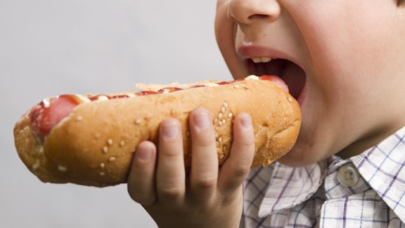 boy is biting a hotdog; Shutterstock ID 112094348; Job: -