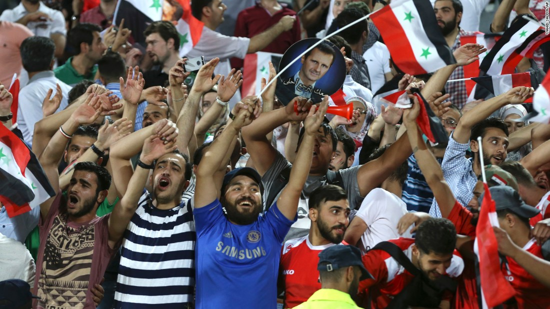 Syria fans celebrate at the end of the match in Tehran.