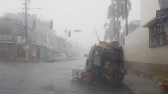 People prepare Wednesday for Irma's arrival in San Juan, Puerto Rico.