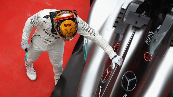 Hamilton pats his Mercedes car after it propelled him to victory at the Shanghai International Circuit. It was his fifth career win in China and saw the Briton draw level on points with Vettel who came home second. Red Bull's Max Verstappen was third.   Drivers' title race after round 2  Vettel 43 points Hamilton 43 points Bottas 23 points