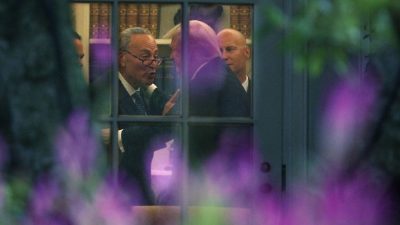 WASHINGTON, DC - SEPTEMBER 06:  U.S. Senate Minority Leader Chuck Schumer (D-NY) (L) makes a point to President Donald Trump in the Oval Office prior to his departure from the White House September 6, 2017 in Washington, DC. President Trump is traveling to North Dakota for a tax reform event with workers from the energy sector.  (Alex Wong/Getty Images)