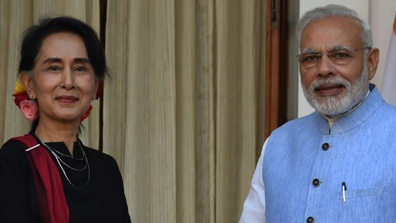 Indian Prime Minister Narendra Modi (R) shakes hand with Myanmar State Counsellor Aung San Suu Kyi before a meeting in New Delhi on October 19, 2016. / AFP / MONEY SHARMA        (Photo credit should read MONEY SHARMA/AFP/Getty Images)