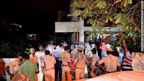 Senior police officials visit the house of 55-year-old Gauri Lankesh, who was shot dead by unknown assailants in the porch of her home in Bangalore on September 5, 2017.