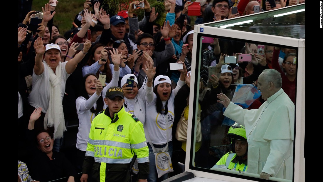 People welcome Francis to Bogota as he makes his way from the airport to the Nunciature on September 6.
