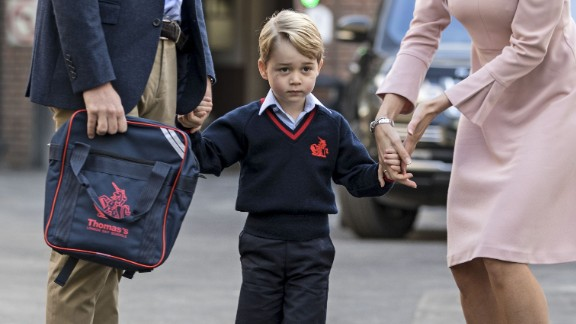 Prince George walks into his new school in south London.