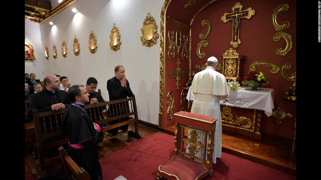 Pope Francis prays in the chapel of the Nunciature in Bogota on September 6.