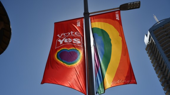 "A ""Vote Yes"" banner in support of same sex-marriage hangs on a street in Sydney on September 5, 2017.  Same-sex marriage advocates launched legal action in Australia"