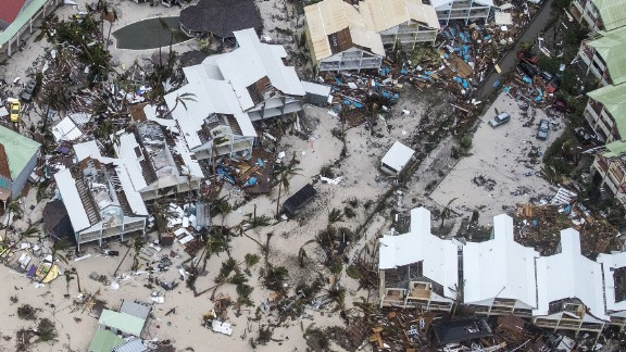"TOPSHOT - An aerial photography taken and released by the Dutch department of Defense on September 6, 2017 shows the damage of Hurricane Irma in Philipsburg, on the Dutch Caribbean island of Sint Maarten. Hurricane Irma sowed a trail of deadly devastation through the Caribbean on Wednesday, reducing to rubble the tropical islands of Barbuda and St Martin. / AFP PHOTO / ANP / Gerben VAN ES / Netherlands OUT / RESTRICTED TO EDITORIAL USE - MANDATORY CREDIT ""AFP PHOTO / DUTCH DEFENSE MINISTRY/GERBEN VAN ES"" - NO MARKETING NO ADVERTISING CAMPAIGNS - NO ARCHIVES - NO SALE- DISTRIBUTED AS A SERVICE TO CLIENTS          (Photo credit should read GERBEN VAN ES/AFP/Getty Images)"