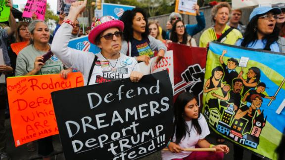 """NEWARK, NJ - SEPTEMBER 06: Immigration activists protest the Trump administration's decision to end the Deferred Action for Childhood Arrivals (DACA) program on September 6, 2017. in Newark, New Jersey. The decision represents a blow to young undocumented immigrants, also known as """"dreamers,"""" who have been shielded from deportation under DACA.  (Photo by Eduardo Munoz Alvarez/Getty Images)"""