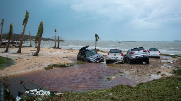 Damaged cars are seen on a St. Martin beach on September 6.