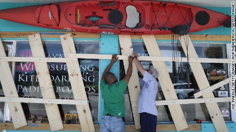 MIAMI, FL - SEPTEMBER 07:  07:Jim DeSilva and Milton Ibanez (L-R) put window protection on their business, Sandy Point, as they prepare for Hurricane Irma on September 7, 2017 in Miami, Florida. It's still too early to know where the direct impact of the hurricane will take place but the state of Florida is in the area of possible landfall.  (Photo by Joe Raedle/Getty Images)