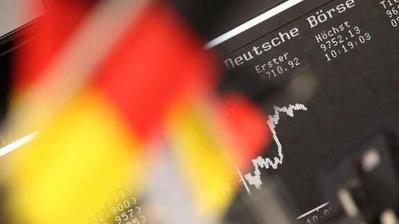 German flags are pictured in front of a display showing the German stock market index DAX at the stock exchange in Frankfurt, Germany, on July 14, 2014. AFP PHOTO / DANIEL ROLAND        (Photo credit should read DANIEL ROLAND/AFP/Getty Images)