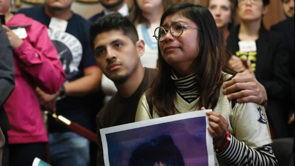 WASHINGTON, DC - SEPTEMBER 6:  Karen Caudillo cries as she looks on during a new conference about President Donald Trump's decision to end the Deferred Action for Childhood Arrivals (DACA) program at the U.S. Capitol September 6, 2017 in Washington, DC. (Photo by Aaron P. Bernstein/Getty Images)