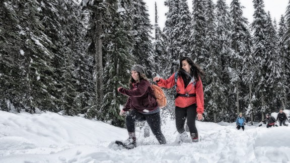 Lylianna Allala, left, an outreach coordinator, races Michelle Piñon, a regional coordinator for Latino Outdoors and trip leader at the Washington Trails Association, at Snoqualmie Pass.