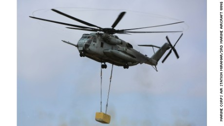 A CH-53E Super Stallion carries a 20,000-pound training load during external lift training at Marine Corps Base Camp Pendleton in California on June 5.