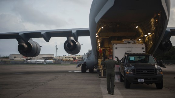 U.S. Air Force C-17 Globemaster III crewmembers from the 14th Airlift Squadron unload supplies during a hurricane relief mission to prepare Puerto Rico for Hurricane Irma at San Juan, Puerto Rico, September 6, 2017.