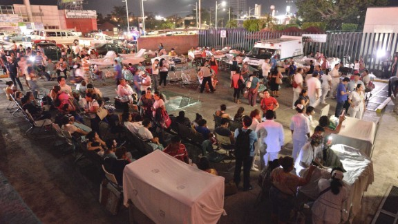 Medical staff and patients wait outside after a hospital was evacuated in Villahermosa, Mexico.
