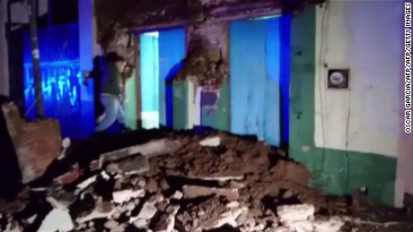A video grab made from AFPTV footage shows damage to a building in downtown Oaxaca on September 8, 2017 after a powerful 8.2-magnitude earthquake rocked Mexico late on September 7, killing at least five people and triggering a tsunami alert in what the president called the quake-prone country's biggest one in a century. / AFP PHOTO / AFPTV / Oscar GARCIA        (Photo credit should read OSCAR GARCIA/AFP/Getty Images)