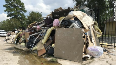 Debris from flooded homes is piled outside in Lakewood near the home of Daniela Alvarado and Leonardo Aguirre.