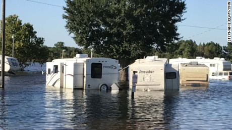 Trailers in an RV park sit in floodwaters from Tiger Creek in Rose City on September 6.