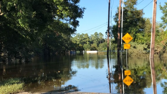 A road in Beaumont, Texas, is still flooded, two weeks after Hurricane Harvey dumped more than 50 inches of rain on parts of the state.