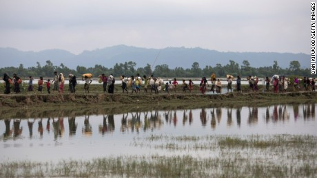 Rohingya Muslim refugees make their way into Bangladesh after crossing the border on September 07.