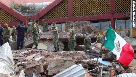 Soldiers remove debris from a partly collapsed municipal building felled by a massive earthquake in Juchitan, Oaxaca state, Mexico, Friday, Sept. 8, 2017. One of the most powerful earthquakes ever to strike Mexico has hit off its southern Pacific coast, killing at least 32 people, toppling houses, government offices and businesses. (AP Photo/Luis Alberto Cruz)