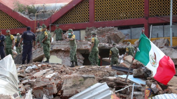 Soldiers remove debris from a partially collapsed municipal building in Juchitan, Mexico, on Friday, September 8. A magnitude-8.1 earthquake was registered the night before off Mexico's southern coast. It is the strongest quake to hit the country in 100 years, according to President Enrique Peña Nieto.
