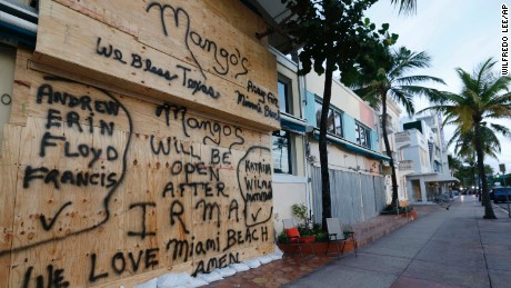 A boarded up building on normally bustling South Beach is shown, Friday, Sept. 8, 2017 in Miami Beach, Fla. The first hurricane warnings were issued for parts of southern Florida as the state braced for what could be a catastrophic hit over the weekend. (AP Photo/Wilfredo Lee)