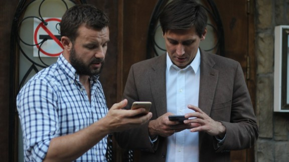 Vitali Shkliarov (L) with opposition politician Dmitry Gudkov.