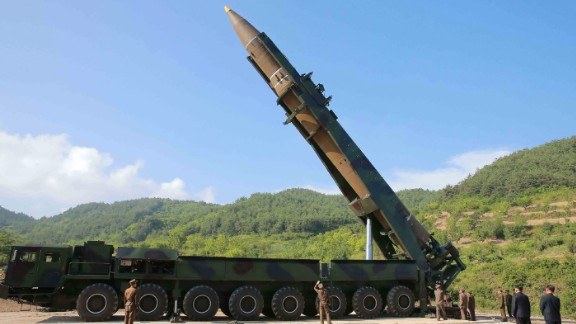 """This picture taken and released on July 4, 2017 by North Korea's official Korean Central News Agency (KCNA) shows North Korean leader Kim Jong-Un (2nd R) inspecting the test-fire of the intercontinental ballistic missile Hwasong-14 at an undisclosed location. North Korea declared on July 4 it had successfully tested its first intercontinental ballistic missile -- a watershed moment in its push to develop a nuclear weapon capable of hitting the mainland United States. / AFP PHOTO / KCNA VIA KNS / STR / South Korea OUT / REPUBLIC OF KOREA OUT   ---EDITORS NOTE--- RESTRICTED TO EDITORIAL USE - MANDATORY CREDIT """"AFP PHOTO/KCNA VIA KNS"""" - NO MARKETING NO ADVERTISING CAMPAIGNS - DISTRIBUTED AS A SERVICE TO CLIENTS THIS PICTURE WAS MADE AVAILABLE BY A THIRD PARTY. AFP CAN NOT INDEPENDENTLY VERIFY THE AUTHENTICITY, LOCATION, DATE AND CONTENT OF THIS IMAGE. THIS PHOTO IS DISTRIBUTED EXACTLY AS RECEIVED BY AFP.   /         (Photo credit should read STR/AFP/Getty Images)"""