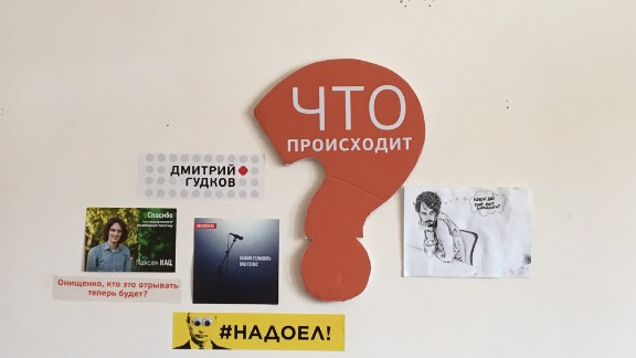 "Opposition slogans, such as a yellow sticker featuring Putin's face and the words ""#fedup,"" is seen inside the movement's headquarters in Moscow in August."