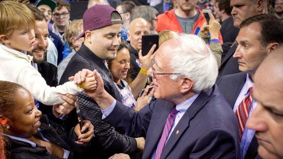 Vitali Shkliarov and his son, Nikita, shake hands with Bernie Sanders on the campaign trail.