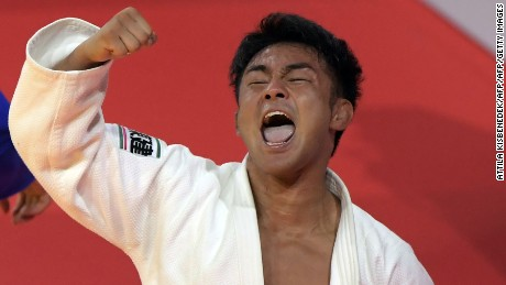 Japan's Soichi Hashimoto (white) celebrates his victory over Azerbaian's Rustam Orujov (not pictured) after their final in the mens -73kg category at the World Judo Championships in Budapest on August 30, 2017.  / AFP PHOTO / ATTILA KISBENEDEK        (Photo credit should read ATTILA KISBENEDEK/AFP/Getty Images)