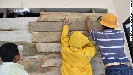 Workers of a hotel cover windows with wood boards in anticipation of the arrival of Hurricane Katia in Tecolutla, Veracruz State, Mexico on September 8, 2017. Hurricane Katia strengthened to Category Two storm on a scale of five on Friday as it raged towards the eastern coast of Mexico, authorities said.  / AFP PHOTO / Yuri CORTEZ        (Photo credit should read YURI CORTEZ/AFP/Getty Images)
