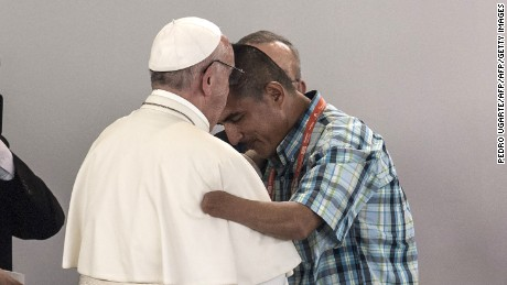 "Pope Francis (L) hugs former guerilla Juan Carlos Murcia during a reconciliation ceremony in Villavicencio, Colombia, on September 8, 2017.  On the third day of his trip to the country, Pope Francis held an open air mass ahead of a separate ""prayer for national reconciliation"" for victims and former guerrilla and state combatants. / AFP PHOTO / PEDRO UGARTE        (Photo credit should read PEDRO UGARTE/AFP/Getty Images)"