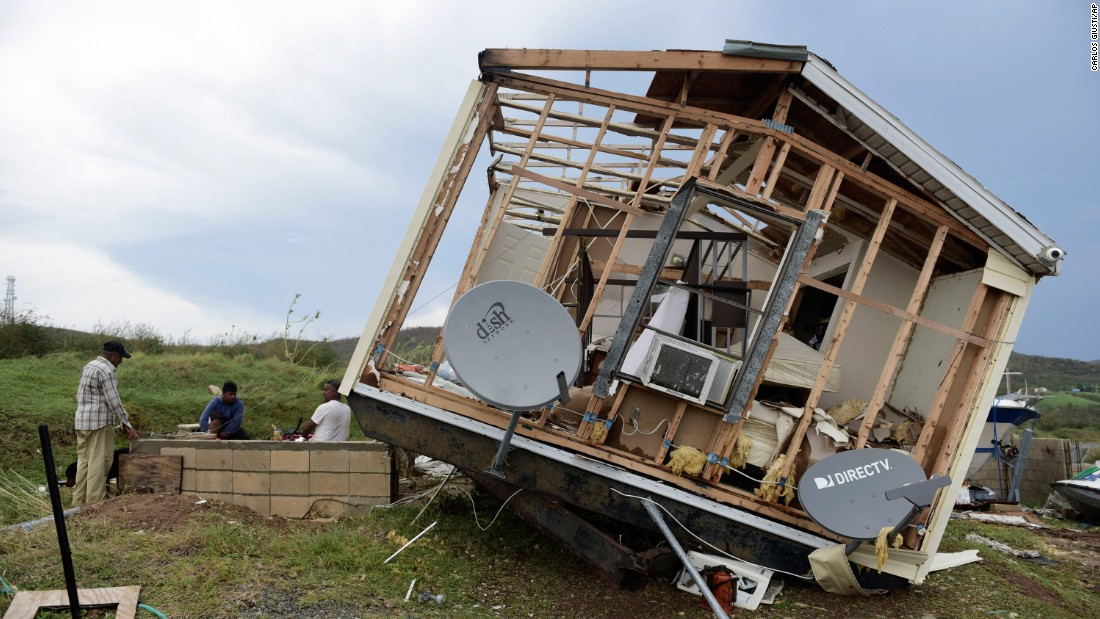 A damaged home is tilted onto its side on the Puerto Rican island of Culebra on Thursday, September 7.