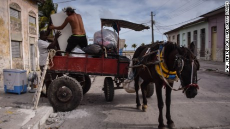 Men in Caibarien, Cuba, prepare Friday for the storm.
