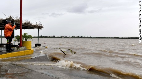 A man takes a video while watching the Tecolutla River during strong winds and rain before the arrival of Hurricane Katia in Tecolutla, Veracruz state, Mexico on September 8, 2017.  Hurricane Katia strengthened to Category Two on the Saffir-Simpson scale of five as it raged towards the eastern coast of Mexico, Mexico's National Water Commission (Conagua) reported. / AFP PHOTO / YURI CORTEZ        (Photo credit should read YURI CORTEZ/AFP/Getty Images)