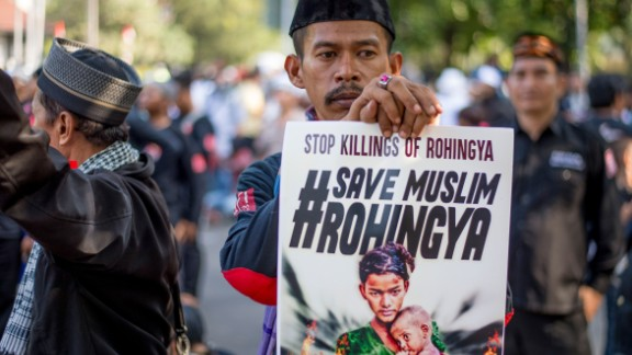 A demonstrator displays a placard during an anti-Myanmar rally to condemn the worsening humanitarian situation in Rakhine state, in front of the Myanmar embassy in Jakarta on September 8, 2017. Persecution of Rohingya Muslims, reviled as illegal immigrants and mostly denied citizenship in Myanmar, has been a lightning rod for anger in Indonesia and across the Muslim world. / AFP PHOTO / Bay ISMOYO        (Photo credit should read BAY ISMOYO/AFP/Getty Images)