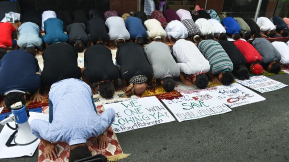 Philippine Muslims pray during a protest in front of the Myanmar embassy in Manila on September 8, 2017.