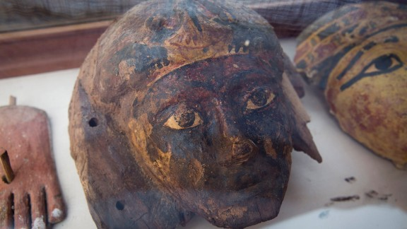 Authorities put a number of the findings on display outside the tomb, including statues, pots and funerary masks.