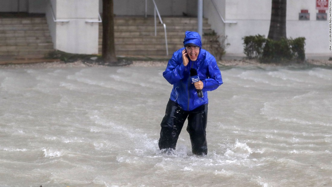 Weather Channel meteorologist Mike Seidel fights fierce winds and flooded streets while reporting in Miami on September 10.