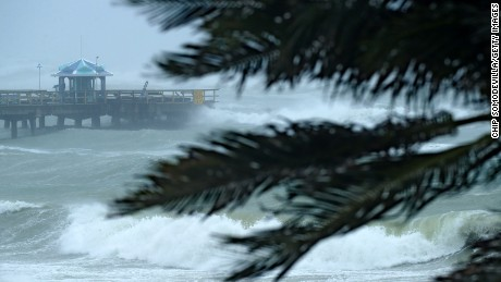 Large waves crash into the end of Anglins Fishing Pier in Fort Lauderdale, Florida, on September 10.