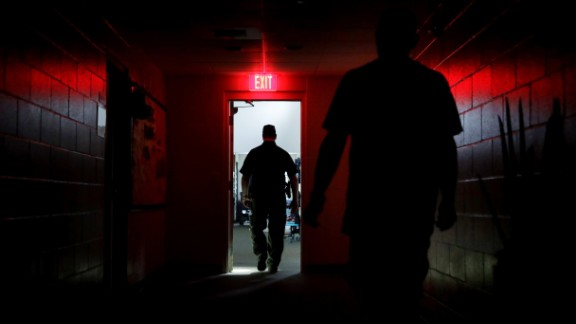 A sheriff's deputy walks through a shelter in Naples after the power went out on September 10.
