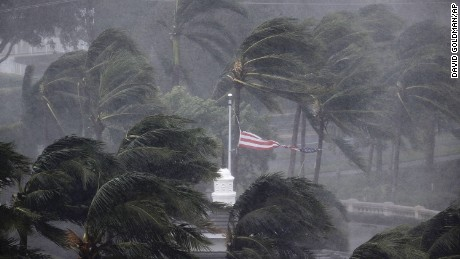An American flag is torn as Hurricane Irma passes through Naples, Florida on September 10.