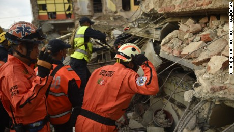 "Members of the ""Topos"" (Moles), a specialized rescue team, search for survivors following the 8.2 magnitude earthquake that hit Mexico's Pacific coast, in Juchitan de Zaragoza, state of Oaxaca on September 8, 2017.  Mexico's most powerful earthquake in a century killed at least 35 people, officials said, after it struck the Pacific coast, wrecking homes and sending families fleeing into the streets. / AFP PHOTO / PEDRO PARDO        (Photo credit should read PEDRO PARDO/AFP/Getty Images)"