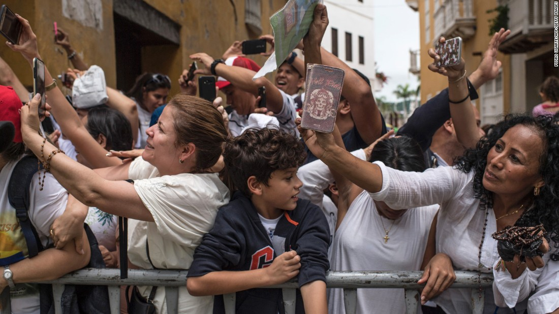 Colombian faithful take pictures of Pope Francis as he leaves San Pedro Claver church in Cartagena, Colombia on September 10, 2017.